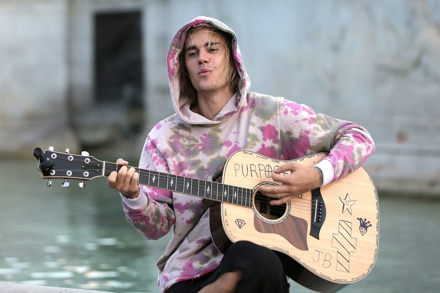 Justin Bieber Dominates The Charts By Disappearing Into Hits
