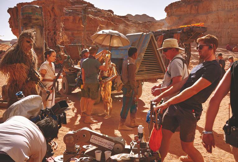 Joonas Suotamo (Chewbacca), Ridley, Daniels, and John Boyega (Finn) await the call to action for a chase scene