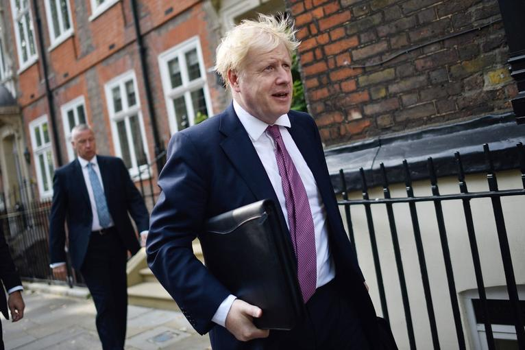 Boris Johnson wearing the standard-issue outfit of white masculine supremacy