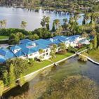 Go Inside Shaquille O'Neal's Jaw-Dropping $27M Florida Mansion, Complete With 17-Car Garage